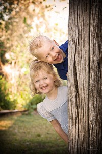 A lovely shot of children playing peek-a-boo. Hilarious portrait photo shoots are often the outcome when working with kids.