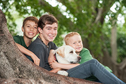 Outdoor family photos 3 boys and their beloved dog.