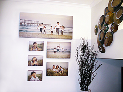 When you receive your new family portraits the first question is how to hang wall art.